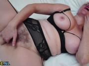 Big boobed hairy mature toying her cunt