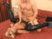 PVC slut shagged in bed