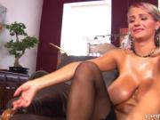 Young Darina massaging her big tits