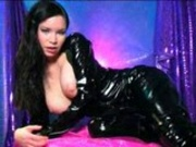 Woman in PVC Catsuit seduces