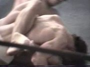 Two dudes wrestle and enable their bodys