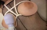 Hothead asian chick poses in fishnet pantyhose then blowjobs and titfucks man