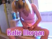 Teen Katie Morgan with pig tails gives holes to a firm pecker
