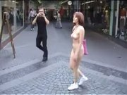 Busty Nudist Babe Walks Downtown Absolutely Naked