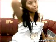 Asian Cutie Teases Her Pussy