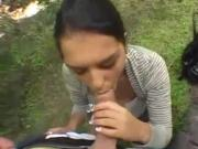 Racy Gal Stuffs Thing In Mouth Outside