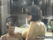 Busty MILF In The Kitchen