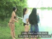 Lesbians play with pussies outdoors