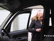 Blonde gets big tits massaged in cab
