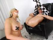 Horny lesbians fill up their big fannys with milk and squirt it out