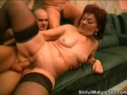 Sexy Mature Redhead Shares a Cock