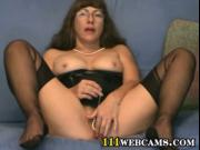 Mature woman in glasses and in nylons plays with her pu