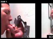 Gay brunette fellating large cock on gloryhole