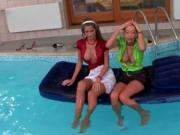 Two horny wet babes getting dirty in the swimming pool