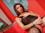 Redhead shemale Bruna Kobolt masturbates her hard cock