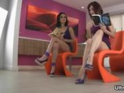 Awesome girls sitting on sofa, shows their long legs wh