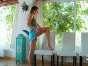Lovely teen touching her hot body on a chair