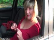 Nasty mature woman gets horny showing off her huge tits