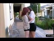 Excited teen dyke lovers making out in public