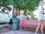 Gorgeous hot teen blonde is walking on the street, she