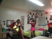College girls playing dress up in dorm room