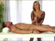 Luscious masseuse blowjobs her client's big hard cock
