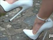Tall And White High Heels Outside