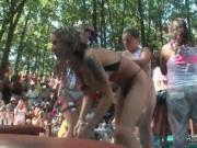 Busty girls flashing their big tits in an outdoor party