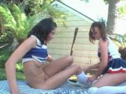 Two brunette cheerleaders exploring each others wet pin