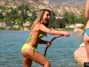 Two bikini babes pleasuring each others pussies outdoor