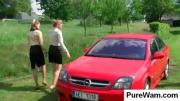 Chicks washing the car outdoors
