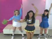 Three teen cheerleaders showing each other their huge c