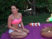Sexy brunette lesbians get horny getting naked outdoor
