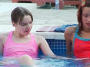 Lesbian teen duo Ivana and Natasha stripping in pool