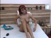 Beautyful redhead play with toy on webcam