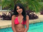 Gorgeous latina takes off her swim suit by the pool