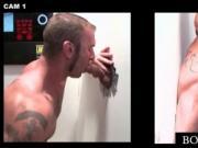 Tattooed gay hand fucks and eats gloryhole cock