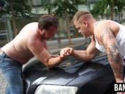 Hunks measure their strenght with an arm wrestling cont
