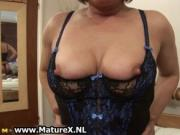 Mature mom in sexy black stockings showing of her curvy