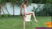 Teen girl fingers pussy outdoors