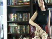 Aroused skanky dark haired whore gets naked while smoki
