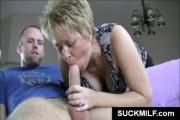 MILF in glasses give blowjob in POV