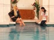 Sexy blonde babes go crazy playing dressed in the pool