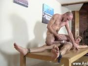 Gay movie Brit twink Oli Jay is roped down to the table