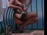 Sexy blonde babe in black stockings rubbing her horny b