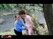 Older woman helps naked guy cum by the riverside CFNM