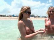Blondes at the beach flashing their sexy tits and butts