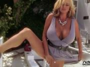 Awesome blonde sat on a chair has massive tits and half