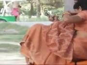 Divi Park Couple on Bench Boob Tease