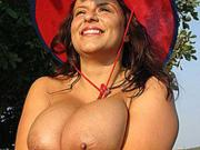 Aneta Buena in red on the beach